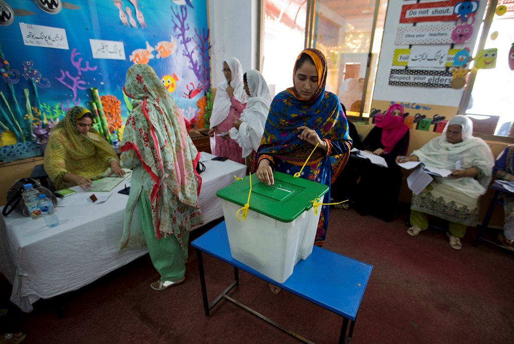 Islamabad : A Pakistani woman casts her vote at a polling station for the parliamentary elections in Islamabad, Pakistan, Wednesday, July 25, 2018. After an acrimonious campaign, polls opened in Pakistan on Wednesday to elect the country's third straight civilian election, a first for this majority Muslim nation that has been directly or indirectly ruled by its military for most of its 71-year history.AP/PTI(AP7_25_2018_000028B)