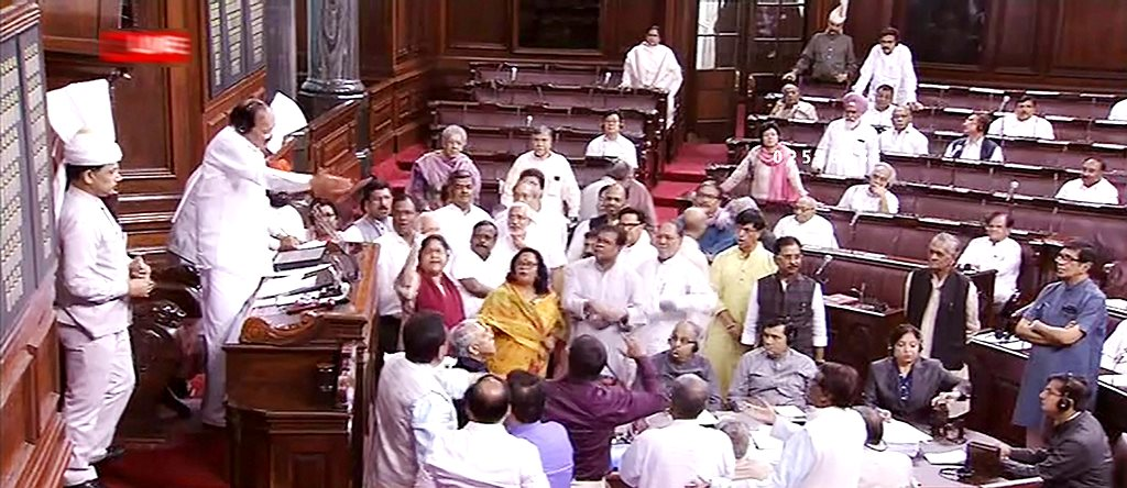 New Delhi: Rajya Sabha Chairman M Venkaiah Naidu tries to pacify the opposition members who were protesting in the well of the Houyse, during the Monsoon session of Parliament, in New Delhi on Tuesday, July 31, 2018. (RSTV GRAB via PTI) (PTI7_31_2018_000089B)