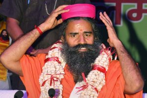 Patna: Swami Ramdev after being offered a 'Makhana-garland' during a function, in Patna on Monday, July 16, 2018. (PTI Photo) (PTI7_16_2018_000021B)