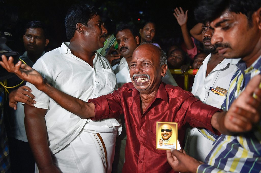 Chennai: Dravida Munnetra Kazhagam (DMK) party cadres react after Kauvery Hospital released a bulletin on party president M. Karunanidhi's health in the evening, in Chennai, on Monday, Aug. 6, 2018. The Kauvery Hospital released a statement at 6:30 pm, saying there is a decline in Mr. Karunanidhi's medical condition and he will have to be monitored for the next 24 hours. (PTI Photo/R Senthil Kumar) (PTI8_6_2018_000205B)(PTI8_6_2018_000233B)