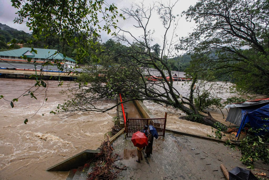 Pathanamthitta: Pampa Manalpuram on the foothills of Sabarimala gets flooded following heavy monsoon rainfall, in Pathanamthitta on Tuesday, Aug 14, 2018. (PTI Photo) (PTI8_14_2018_000230B)