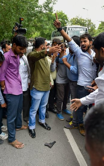 New Delhi: People gather near the pistol which Jawaharlal Nehru University (JNU) student Umar Khalid was allegedly shot at by an unidentified person lies on the road, during an event at the Constitution Club in New Delhi on Monday, Aug 13, 2018. Khalid escaped unhurt. (PTI Photo/Shahbaz Khan) (PTI8_13_2018_000099B)
