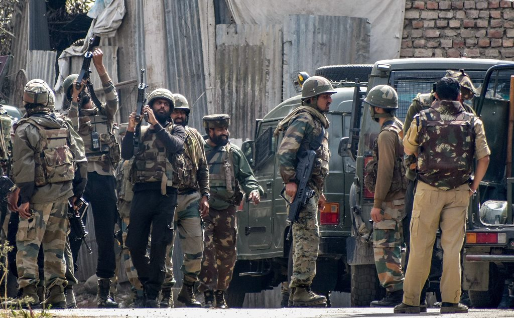 Budgam: Security forces position themselves near the mosque where militants were hiding during an encounter, at Panzan Chadoora area of Budgam district near Srinagar, Thursday, Sept 27, 2018. Five persons, including three militants, were killed in three separate incidents. (PTI Photo) (PTI9_27_2018_000153B)