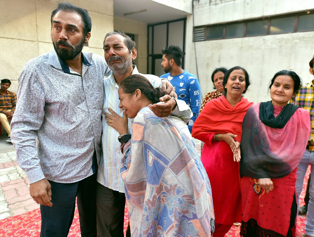Amritsar: Relatives of victims of train accident mourn at Civil Hospital in Amritsar, Saturday, Oct 20, 2018. A speeding train ran over revellers watching fireworks during the Dussehra festival Friday, killing more than 50 people. (PTI Photo/Kamal Kishore)(PTI10_20_2018_000013)