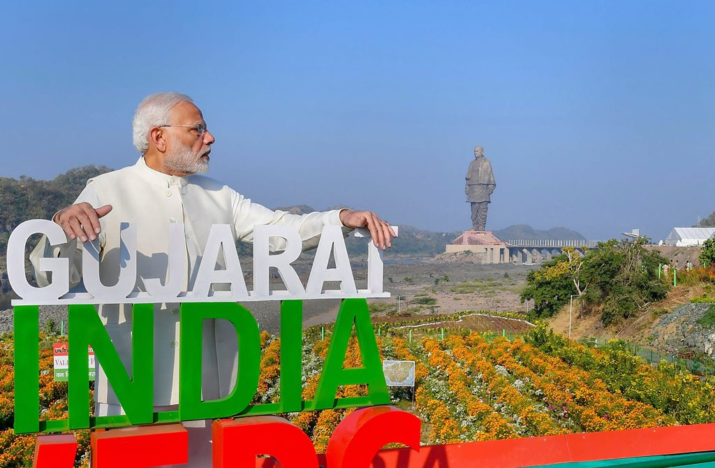 Kevadiya: Prime Minister Narendra Modi at the inauguration of 'Valley of Flowers', overlooking a 182-meters high statue of Sardar Vallabhbhai Patel, on the occasion of Rashtriya Ekta Diwas, at Kevadiya colony of Narmada district, Wednesday, Oct 31, 2018. (PIB Photo via PTI) (PTI10_31_2018_000102)