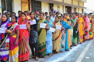 Raipur: Voters stand in a queue at a polling station to cast their votes for the 2nd phase of Assembly elections, in Raipur, Tuesday, Nov.20, 2018. (PTI Photo)(PTI11_20_2018_000037B)
