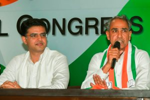 New Delhi: Dausa MP Harish Chandra Meena speaks at a press conference after joining the Congress party, at AICC headquarters in New Delhi, Wednesday, Nov 14, 2018. Rajasthan Congress chief Sachin Pilot is also seen. (PTI Photo/Subhav Shukla) (PTI11_14_2018_000097)