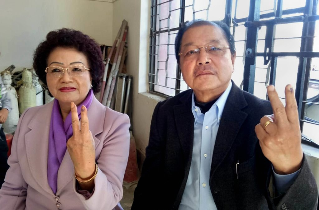 Aizawl: Mizoram Chief Minister Lal Thanhawla and his wife Lal Riliani show their ink-marked fingers after casting their vote for the state Assembly elections at Zarkawt-II polling station in Aizawl, Wednesday, Nov. 28, 2018. (PTI Photo) (PTI11_28_2018_000092)