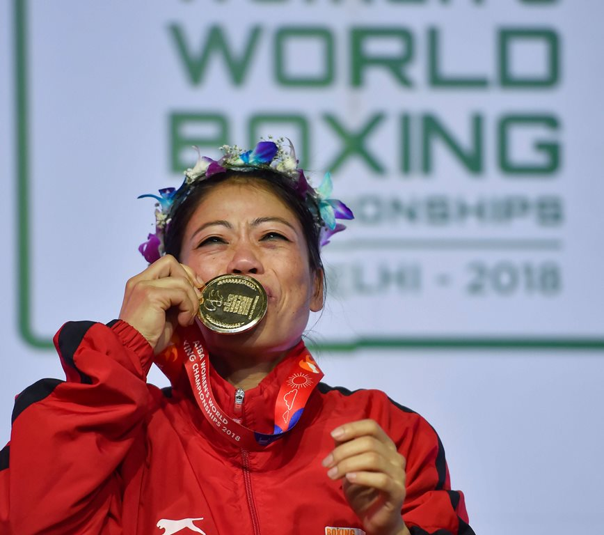 New Delhi: Indian boxer Mary Kom kisses her gold medal after winning the final match of women's light flyweight 45-48 kg against Ukraine's Hanna Okhota at AIBA Women's World Boxing Championships, in New Delhi, Saturday, Nov. 24, 2018. (PTI Photo/Ravi Choudhary) (PTI11_24_2018_000066)