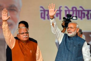 Gurugram: Prime Minister Narendra Modi and Haryana Chief Minister Manohar Lal Khattar waves to the crowd during 'Jan Vikas' rally, at Sultanpur village, in Gurugram, Monday, Nov. 19, 2018. (PTI Photo/Kamal Kishore)(PTI11_19_2018_000092B)