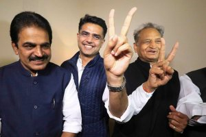 Jaipur: Congress leaders Ashok Gehlot (R) and Sachin Pilot (C) flash victory signs as K.C. Venugopal looks on after the declaration of Rajasthan Assembly election result, in Jaipur, Tuesday, Dec. 11, 2018. (PTI Photo)