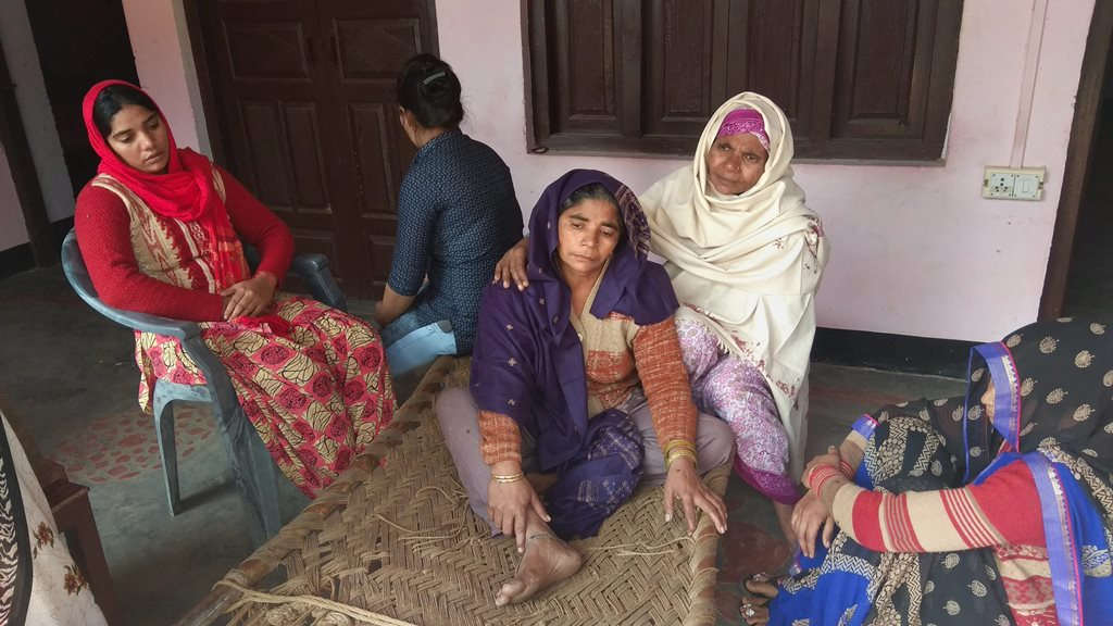 Bulandshahr: Geeta, mother of 20-yr old Sumit Kumar who was killed in Monday's mob violence, mourns along with other family members at their village Chingrawati, in Bulandshahr, Tuesday, Dec. 4, 2018. Violent clashes, which erupted Monday over alleged illegal slaughter of cattle claimed the lives of local youth Sumit and police inspector Subodh Kumar Singh. (PTI Photo) (PTI12_4_2018_000101B)