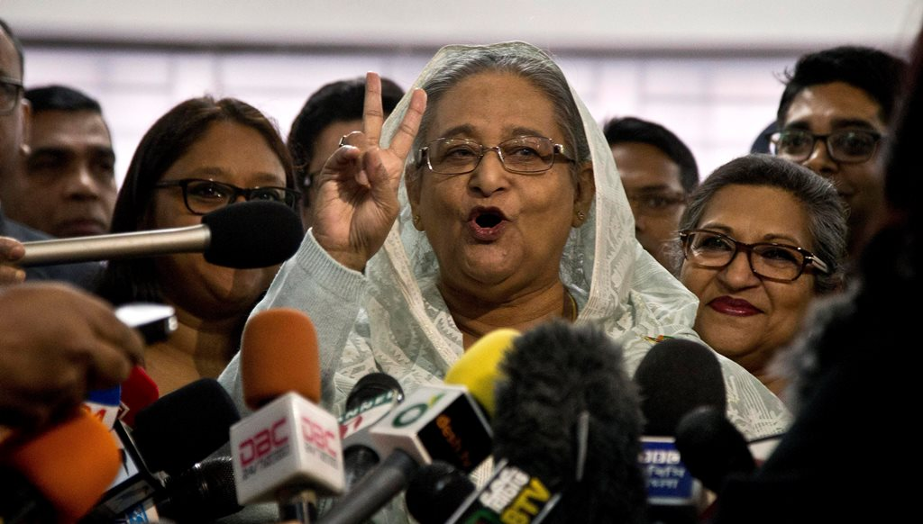 Dhaka : Bangladesh Prime Minister Sheikh Hasina flashes a victory sign as she speaks to the media persons after casting her vote in Dhaka, Bangladesh, Sunday, Dec. 30, 2018. Voting began Sunday in Bangladesh's contentious parliamentary elections, seen as a referendum on what critics call Prime Minister Sheikh Hasina's increasingly authoritarian rule.AP/PTI(AP12_30_2018_000035B)