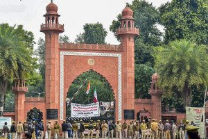 Aligarh: Police personnel deployed on the campus of Aligarh Muslim University in the view of protests after some students were booked on alleged sedition charges, in Aligarh, Friday, Feb 15, 2019. (PTI Photo) (PTI2_15_2019_000168B)