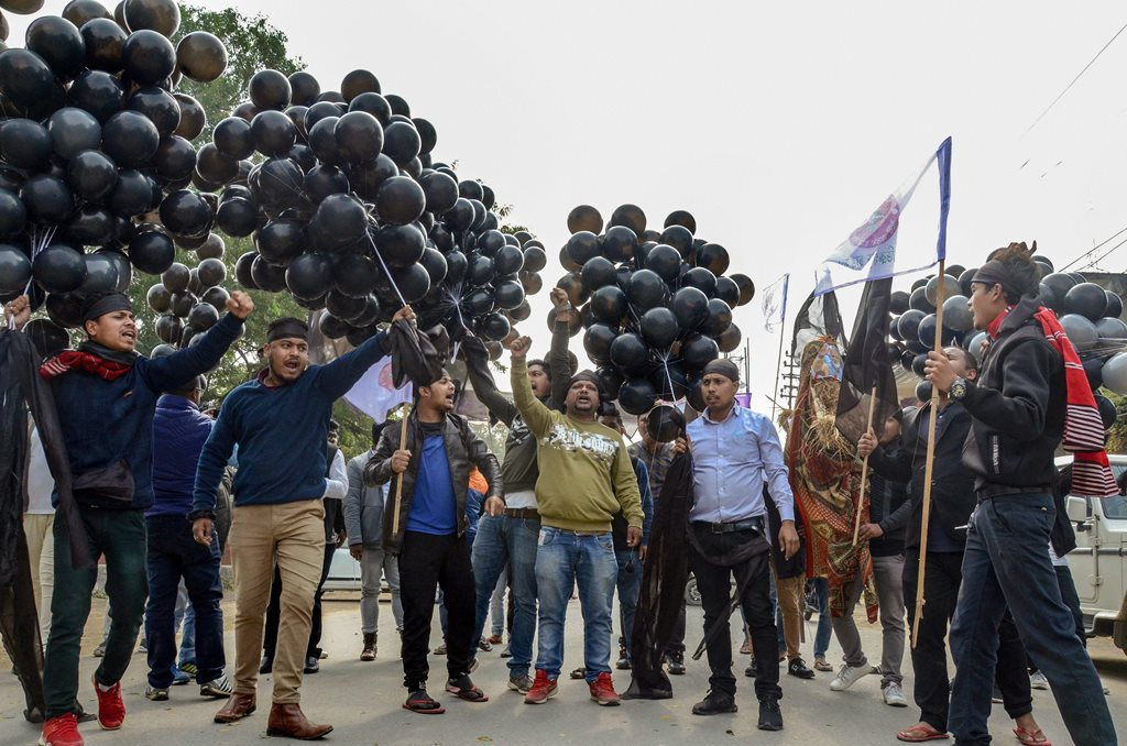 Dibrugarh: All Assam Students' Union (AASU) memebrs display black ballons on Prime Minister Narendra Modi's arrival in protest over Citizenship Amendment Bill, in Dibrugarh, Saturday, Feb 9, 2019. (PTI Photo) (PTI2_9_2019_000022B)