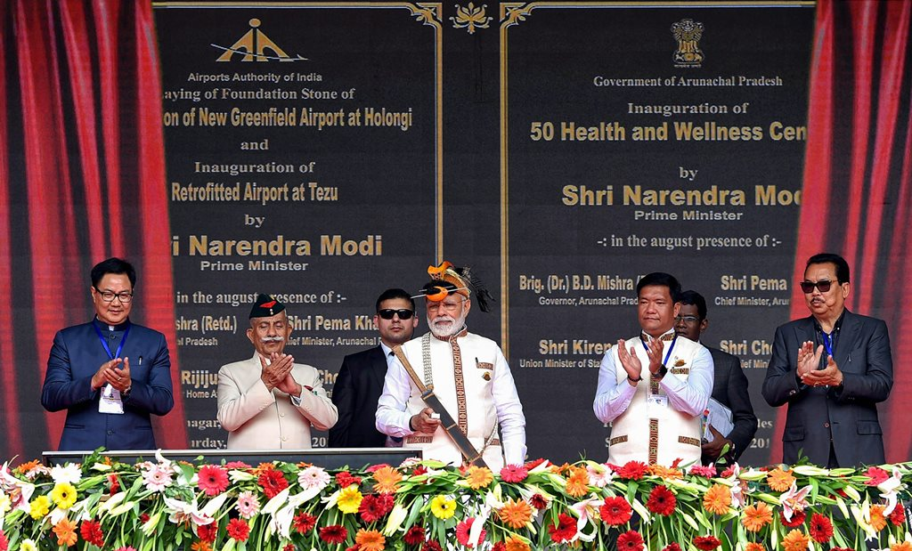 Itanagar: Prime Minister Narendra Modi at the inauguration of several development projects, in Itanagar, Saturday, Feb 9, 2019. Arunachal Pradesh Governor BD Mishra, Chief Minister Pema Khandu and MoS for Home Affairs Kiren Rijiju are also seen. (PIB Photo via PTI) (PTI2_9_2019_000029B)