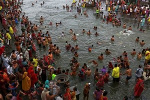 "Hindu devotees pray while standing in the Godavari river during ""Kumbh Mela"" or the Pitcher Festival in Nashik, India, August 28, 2015. Hundreds of thousands of Hindus took part in the religious gathering at the banks of the Godavari river in Nashik city at the festival, which is held every 12 years in different Indian cities. REUTERS/Danish Siddiqui"