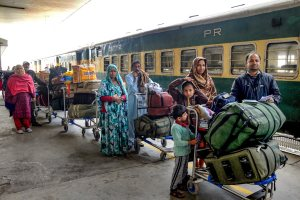 Attari: Passengers, arriving from Pakistan by Samjhauta Express train, wait for custom-check at Attari railway station, near Amritsar, Monday, Feb 25, 2019. (PTI Photo) (PTI2_25_2019_000137B)