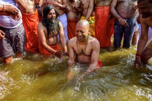 Allahabad: Uttar Pradesh Chief Minister Yogi Adityanath takes a holy dip in the water of River Ganga at Sangam during the ongoing Kumbh Mela-2019, in Allahabad, Tuesday, Jan. 29, 2019. (PTI Photo)(PTI1_29_2019_000066B)
