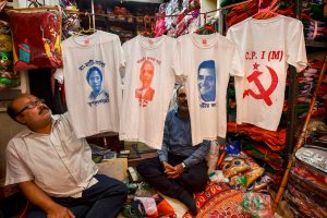 Kolkata: A shopkeeper displays T-shirts with portraits of politicians printed on them, ahead of the Lok Sabha polls, in Kolkata, Thursday, March 14, 2019. (PTI Photo/Swapan Mahapatra)(PTI3_14_2019_000108B)