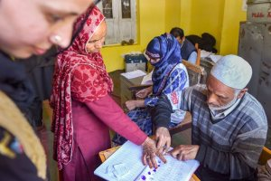 Ananatnag: An elderly voter puts her thumb impression before casting her vote at a polling station during the third phase of Lok Sabha elections, in Anantnag, Tuesday, April 23, 2019. (PTI Photo/S Irfan) (PTI4_23_2019_000223B)