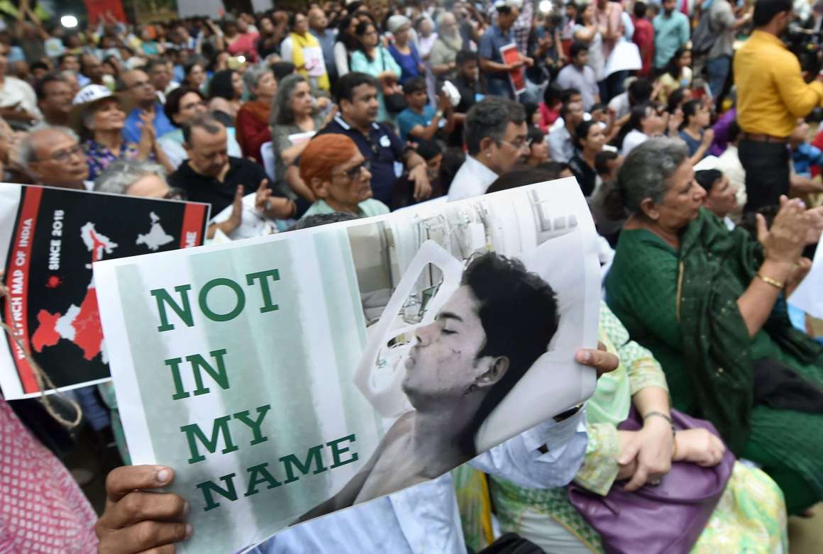 "New Delhi : Citizens hold placards during a silent protest "" Not in My Name "" against the targeted lynching, at Jantar Mantar in New Delhi on Wednesday. PTI Photo by Shahbaz Khan(PTI6_28_2017_000201a)"