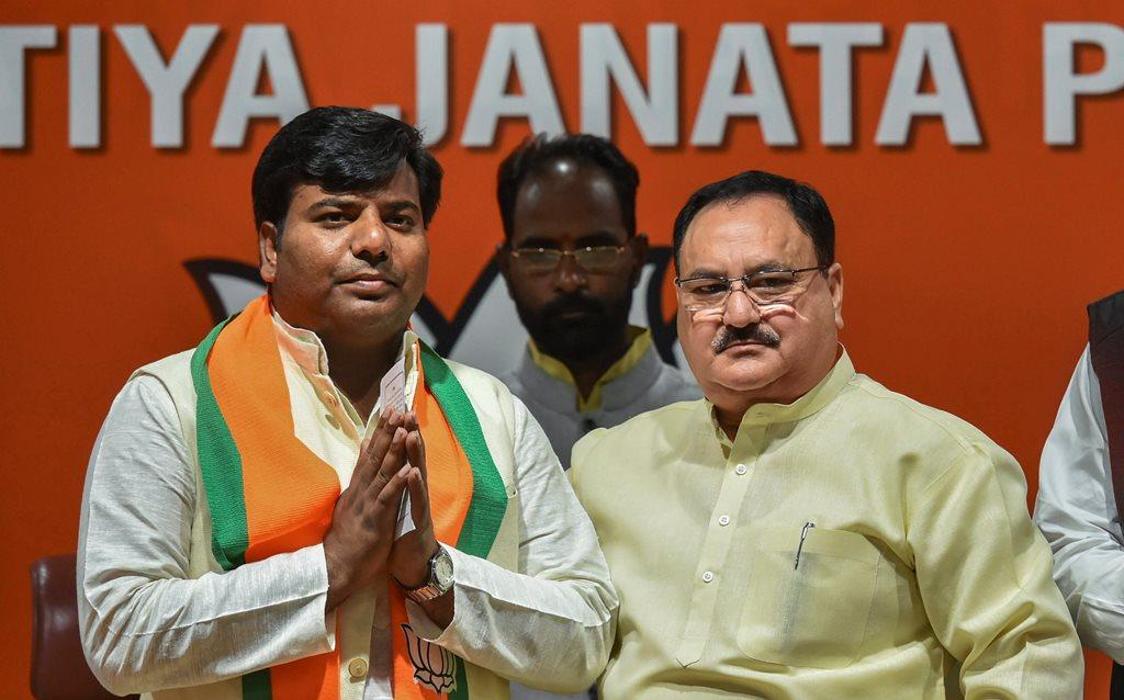 New Delhi: Bharatiya Janata Party leader and Union Minister JP Nadda greets Nishad Party leader and Gorakhpur (UP) MP Praveen Nishad after he joined BJP, in New Delhi, Thursday, April 04, 2019. (PTI Photo/Arun Sharma)(PTI4_4_2019_000037B)