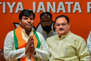 New Delhi: Bharatiya Janata Party leader and Union Minister JP Nadda greets Nishad Party leader and Gorakhpur (UP) MP Praveen Nishad after he joined BJP, in New Delhi, Thursday, April 04, 2019. (PTI Photo/Arun Sharma)(PTI4_4_2019_000037B)