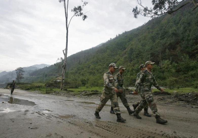 Indian army soldiers march near an army base on India's Tezpur-Tawang highway in Arunachal Pradesh May 29, 2012. REUTERS/Frank Jack Daniel/Files