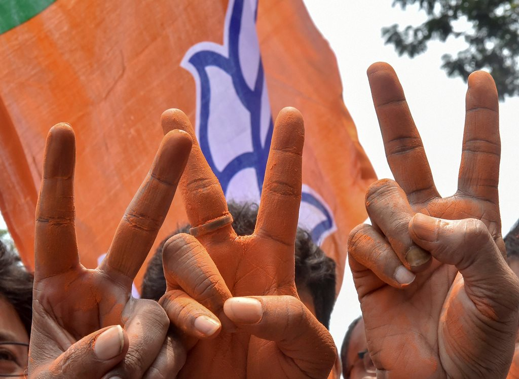 Kolkata: BJP supporters show victory sign as they celecbrate their party's lead in the Lok Sabha elections, at BJP office, in Kolkata, Thursday, May 23, 2019. (PTI Photo/Ashok Bhaumik) (PTI5_23_2019_000073B)