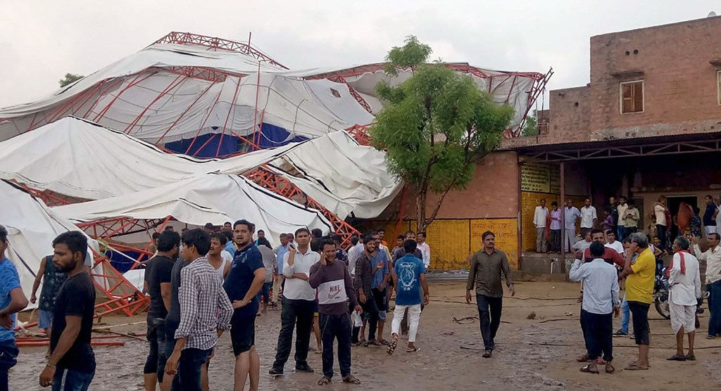 Barmer: Panic stricken people after a pandal fell during a Ram Katha due to storm in Jasol village of Barmer district of Rajasthan, Sunday, June 23, 2019. At least 14 people reportedly dead in the mishap. (PTI Photo)