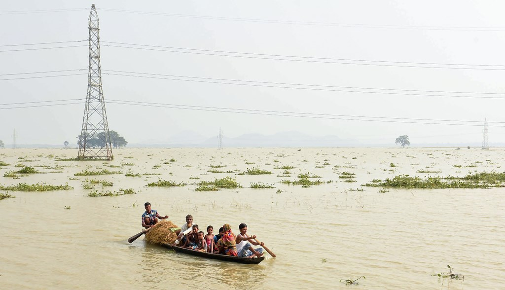 Morigaon: Villagers relocate to a safer place from their flood-affected village following monsoon rains, in Morigoan, Friday, July 19, 2019. (PTI Photo) (PTI7_19_2019_000228B)