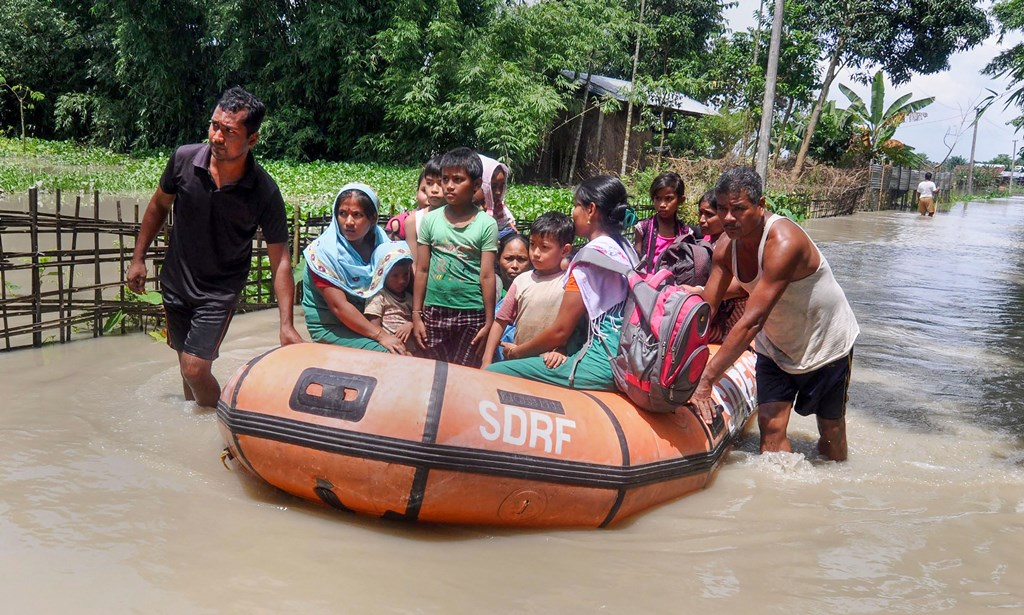 Barpeta: State Disaster Response Force (SDRF) personnel rescue villagers affected by flood at Sarukhetri village in Barpeta, Thursday, July 25, 2019. (PTI Photo) (PTI7_25_2019_000117B) *** Local Caption ***