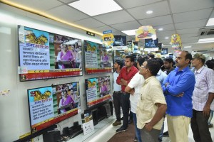 Patna: People watch Finance Minister Nirmala Sitharaman tabling the Union Budget 2019-20, on TV sets at a showroom in Patna, Friday, July 5, 2019. (PTI Photo)(PTI7_5_2019_000062B)
