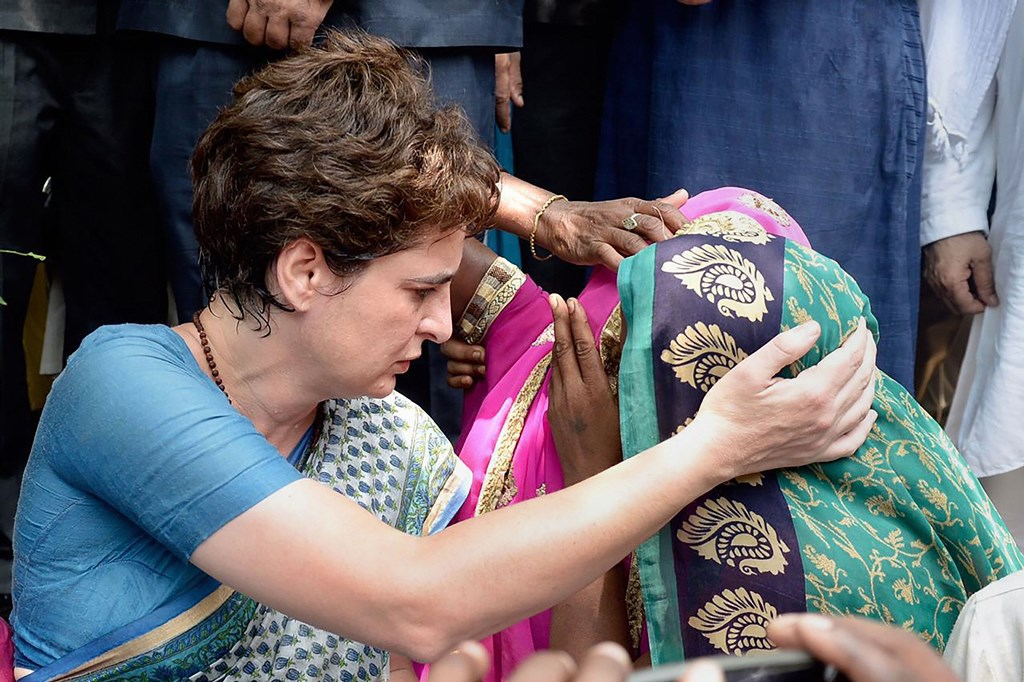 Mirzapur: Congress General Secretary Priyanka Gandhi Vadra consoles a family member of Sonbhadra massacre victim, who had travelled to Chunar Fort to meet her after the former was stopped from proceeding to Sonbhadra, in Mirzapur, Saturday, July 20, 2019. Aleast 10 people were killed in a shootout on Wednesday over a land dispute in Sonbhadra. (PTI Photo)(PTI7_20_2019_000039B)