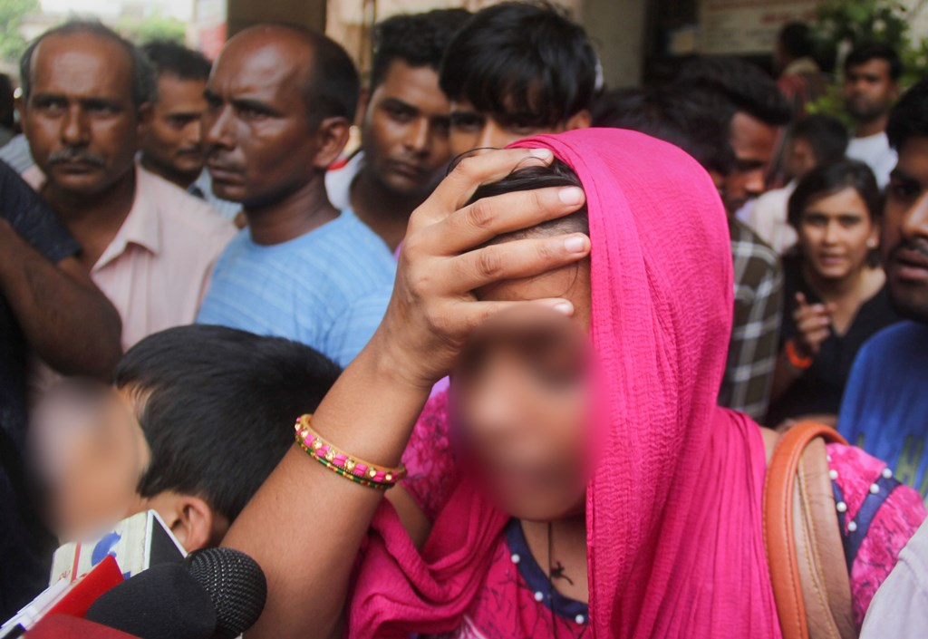 Lucknow: A relative of the Unnao rape survivor talks to the media outside KGMC Hospital where she is being treated, in Lucknow, Monday, July 29, 2019. The rape survivor got injured in a road accident near Raebareli, Sunday. (PTI Photo) (PTI7_29_2019_000224B)