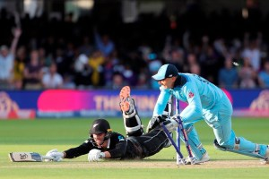 London: England's Jos Buttler runs out New Zealand's Martin Guptill during the Super Over in the Cricket World Cup final match between England and New Zealand at Lord's cricket ground in London, England, Sunday, July 14, 2019. AP/PTI(PTI7_15_2019_000030B)