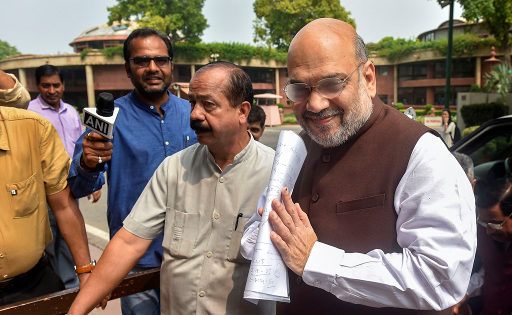 New Delhi: Union Home Minister Amit Shah arrives at Parliament for the Budget Session, in New Delhi, Monday, Aug 5, 2019. Home Minister will make a statement in Parliament today amidst speculation that it could be on Jammu and Kashmir.(PTI Photo/Manvender Vashist) (PTI8_5_2019_000033B)