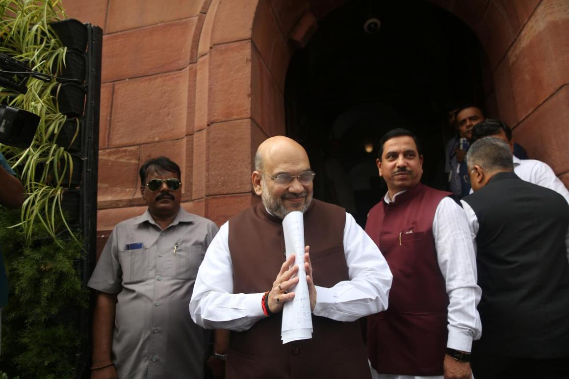India's Home Minister Amit Shah greets the media upon his arrival at the parliament in New Delhi, India, August 5, 2019. REUTERS/Stringer