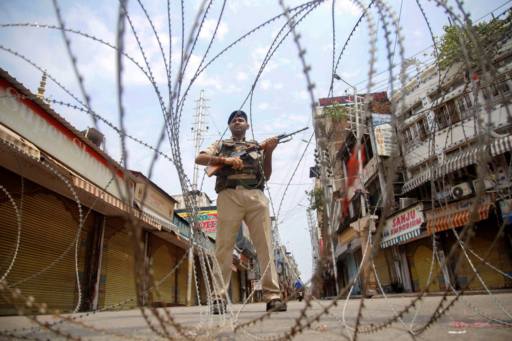 Jammu: CRPF personnel stand guard during restrictions, at Raghunath Bazar in Jammu, Monday, Aug 05, 2019. Restrictions and night curfews were imposed in several districts of Jammu and Kashmir as the Valley remained on edge with authorities stepping up security deployment. (PTI Photo)(PTI8_5_2019_000091B)