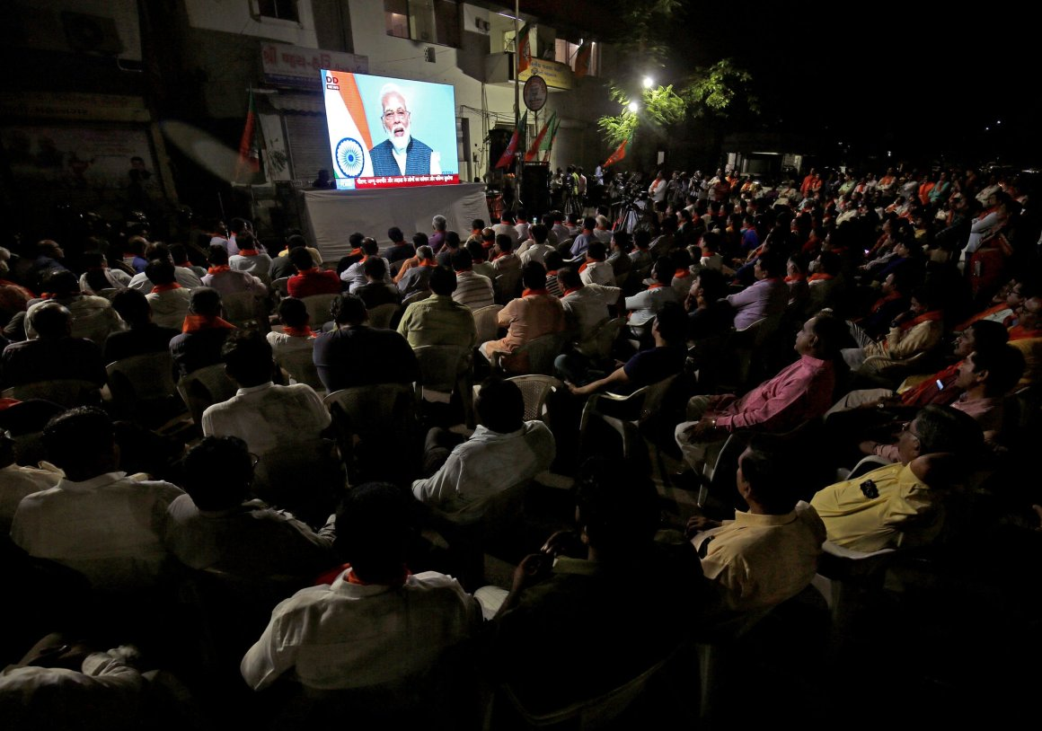 Prime Minister Narendra Modi's televised address to the nation is watched by a crowd in Ahmedabad, India.CreditAmit Dave/Reuters