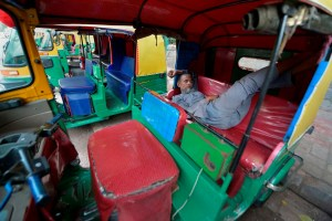 New Delhi: A driver sleeps in his autorickshaw outside New Delhi Railway Station as most of the taxies and auto-rickshaws were off the roads due to transport strike, in New Delhi, Thursday, Sept. 19, 2019.(PTI Photo/Ravi Choudhary)  (PTI9_19_2019_000107B)
