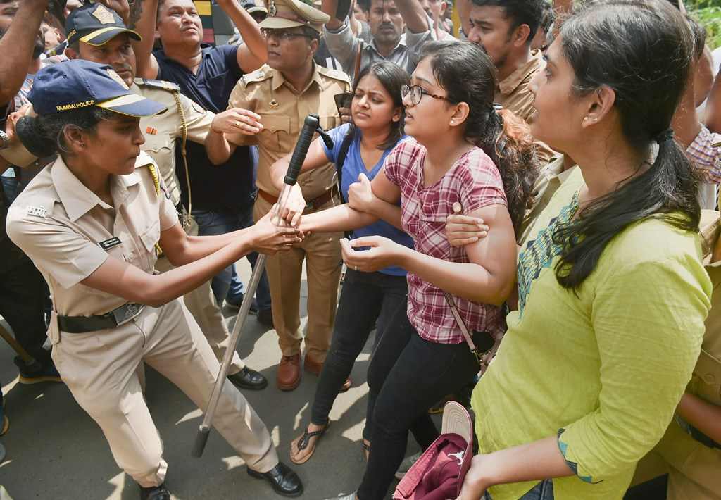 Mumbai: Police detain activists who were staging a protest against the tree-cutting, being carried out for the Metro car shed project, at Aarey colony in Mumbai, Saturday, Oct. 5, 2019. (PTI Photo/Mitesh Bhuvad) (PTI10_5_2019_000065B)