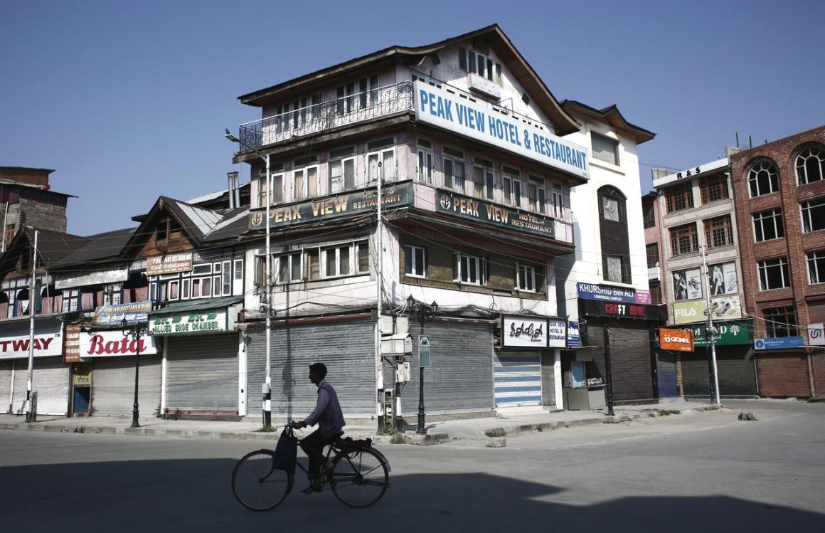 A man rides a bicycle past the closed shops and hotels during restrictions, after scrapping of the special constitutional status for Kashmir by the Indian government, in Srinagar, August 25, 2019. Picture taken August 25, 2019. REUTERS/Adnan Abidi