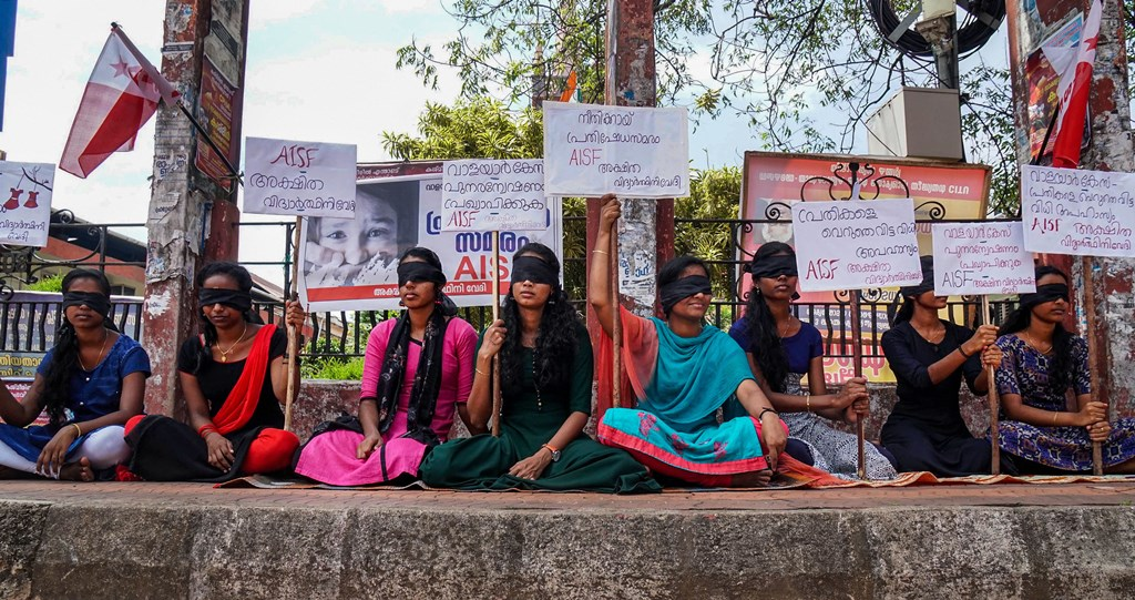 Thrissur: Members of All India Students Federation (AISF) hold placrds as they protest demanding a CBI probe into the 'Walayar Sisters' case, in Thrissur, Monday, Oct. 28, 2019. Two young Dalit girls, sisters, were found hanging in the same place in their single-room house in Wayalar in Palakkad within a gap of three months in 2017. Outrage has intensified following the acquittal of the accused and in light of various discoveries in lapses in the investigation of the case. (PTI Photo) (PTI10_28_2019_000236B)