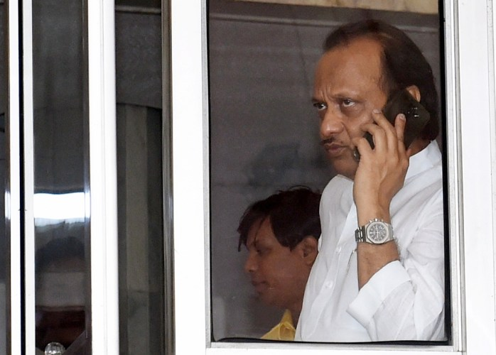 Mumbai: NCP leader Ajit Pawar talks over the phone as he arrives at Maharashtra Vidhan Bhawan, in Mumbai, Wednesday, Nov. 27, 2019. (PTI Photo/Shashank Parade) (PTI11_27_2019_000035B)
