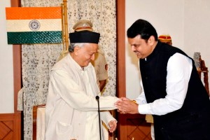 Mumbai: Maharashtra Governor Bhagat Singh Koshyari shakes hands with newly-sworn in Chief Minister of Maharashtra Devendra Fadnavis during oath-taking ceremony, in Mumbai, Saturday, Nov. 23, 2019. (PTI Photo) (PTI11 23 2019 000026B)