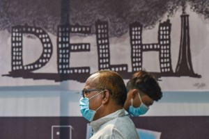 New Delhi: People, wearing masks to get protection from air-pollution, walk along a road in New Delhi, Friday, Nov. 1, 2019. ( PTI Photo/Manvender Vashist)  (PTI11_1_2019_000102B)