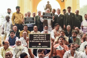 Lucknow: Congress workers stage a dharna against the alleged provident fund (PF) scam in Uttar Pradesh Power Corporation Ltd (UPPCL), at GPO in Lucknow, Monday, Nov. 4, 2019. (PTI Photo/Nand Kumar) (PTI11_4_2019_000159B)