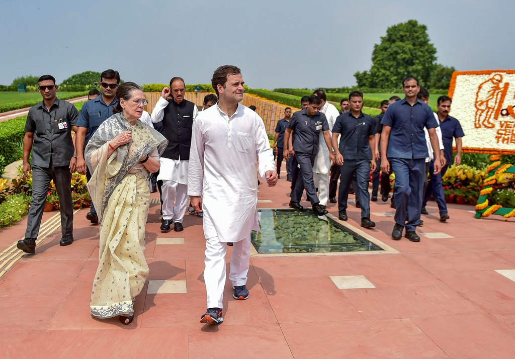 **EDS: FILE PHOTO** New Delhi: In this Oct. 2, 2019 file photo, Congress President Sonia Gandhi with party leader Rahul Gandhi accompanied by SPG leave after paying tribute to Mahatma Gandhi on the 150th birth anniversary at Rajghat in New Delhi. The government has withdrawn the Special Protection Group (SPG) cover of Congress president Sonia Gandhi and her children Rahul and Priyanka, and they will now be given Z-plus security by the CRPF on Friday, Nov. 8, 2019. (PTI Photo/Manvender Vashist)(PTI11_8_2019_000130B)